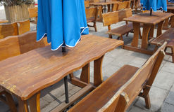 Woodern chair and table outsdie a bar Royalty Free Stock Images