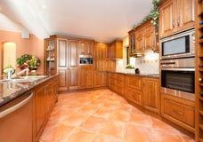 Woodfinish kitchen royalty free stock image