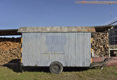 Woodfire and trailer at swiss farm in Bern. Woodfire and trailer at swiss farm. Bern. Switzerland Stock Image