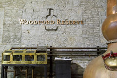 Woodford Reserve Distillery. Versailles, KY, USA - October 19, 2016 : Iconic copper still inside Woodford Reserve Bourbon Distillery with signage and logo royalty free stock photos