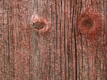Woodgrain. A close-up of red-faded woodgrain on an old barn with knots and cracks Royalty Free Stock Photography
