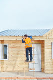 Woodhouse construction. By hard working craftsman Stock Photography