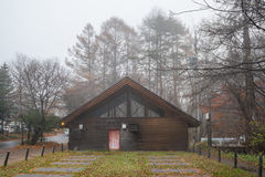 Woodhouse with tree and fog. At Karuizawa Japan Stock Images
