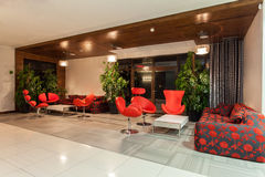 Woodland hotel - Hall. Woodland hotel - Hotel hall with red decorations Royalty Free Stock Photos
