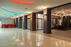 Woodland hotel - hall. With colorful neon lights Stock Photo
