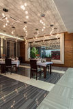 Woodland hotel - Restaurant dining room. Interior, table set Stock Photo