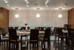 Woodland hotel - tables in restaurant Royalty Free Stock Image