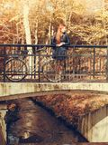 Red haired girl with bike in autumnal park royalty free stock images