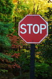 Woodland Stop Sign. Weathered Woodland Stop Sign.  Autumn colors in the background Royalty Free Stock Photos