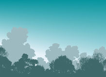 Woodland treetops. Editable  illustration of tree silhouettes and sky Royalty Free Stock Photo