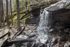 Woodland Waterfall in the Catskill Mountains. A small beautiful waterfall in the eastern Catskill Mountains near North South Lake royalty free stock image