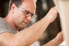 Woodmaker working in his shop or lab Stock Photography