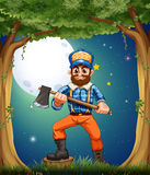 A woodman standing in the middle of the trees Royalty Free Stock Photos