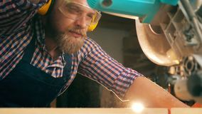 Woodman is using a circular saw in slow motion. HD stock video footage