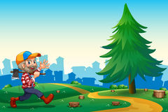 A woodman walking while carrying an axe at the hilltop Royalty Free Stock Images