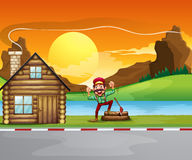 A woodman beside the wooden house Royalty Free Stock Photo