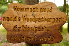 Woodpecker tongue twister. Wooden sign with a wood pecker tongue twister rhyme carved into it at rushcliffe country park, nottinghamshire, england Stock Photography