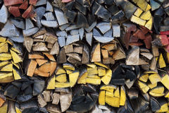 Woodpile. Colored wood pile in a woodshed in Alaska stock image