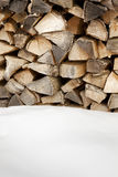 Woodpile. After snowing. Copy space Stock Photos