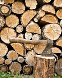Woodpile and axe Stock Images