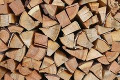 Woodpile, Blockwinde, Brennholz, Bäume, Hintergrund, Beschaffenheitsholzhintergrund Lizenzfreies Stockfoto