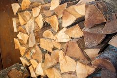 Woodpile of chopped lumber. Pile of wood logs. Stacked firewood timber Royalty Free Stock Photography