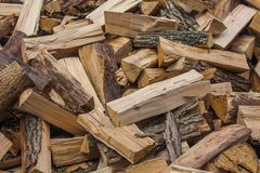 Woodpile of chopped lumber. Pile of wood logs. Stacked firewood timber Stock Images