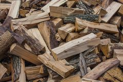 Woodpile of chopped lumber. Pile of wood logs. Stacked firewood timber Stock Photos