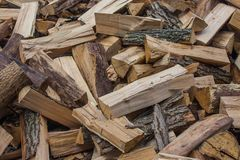 Woodpile of chopped lumber. Pile of wood logs. Stacked firewood timber Stock Photography