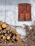 Woodpile and cottage Royalty Free Stock Photo