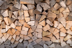 Woodpile with different color shades. Woodpile with firewood in different color shades from gray to brown royalty free stock photography