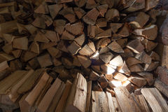 Woodpile of fire wood in a shed Stock Image