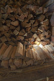 A woodpile of fire wood in a shed Royalty Free Stock Images