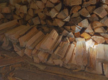 A woodpile of fire wood in a shed Royalty Free Stock Photos