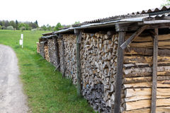 Woodpile of firewood. Chopped firewood for home heating are the woodpiles in the yard Royalty Free Stock Image
