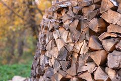 Woodpile. Firewood stacked in a woodpile. Birch wood close up stock photo