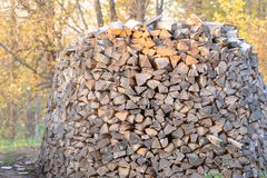 Woodpile. Firewood stacked in a  Large stock of firewood stock images