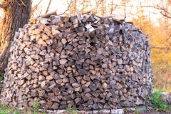 Woodpile. Firewood stacked in a  Large stock of firewood stock photos