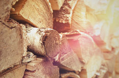 The woodpile of firewood. Sunset Royalty Free Stock Image