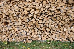 Woodpile background. Woodpile with lots of firewood. Background stock photo