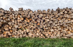 Woodpile on a meadow Stock Photos
