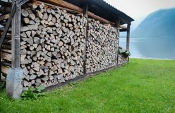 Woodpile on the meadow, near the lake. Austria royalty free stock photos