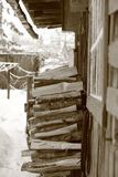 Woodpile near the wall in the village. Woodpile stacked near the wall of the house in the village in winter royalty free stock photos