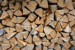 The woodpile. A pile of dry logs, firewood, prepared for the winter season royalty free stock photos