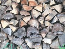 Woodpile. Quartered wood interesting pattern stacked stock photography