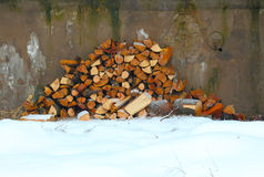 Woodpile on the snow Stock Photography
