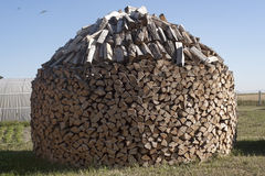 Woodpile stacked circular manner Royalty Free Stock Photography