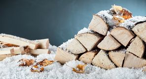 Woodpile with stacked logs and kindling stock photo