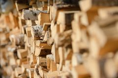Woodpile in the sun. Dry wood. Village life. The reverse side of a barn stock photo