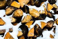 Woodpile under snow cover stock images
